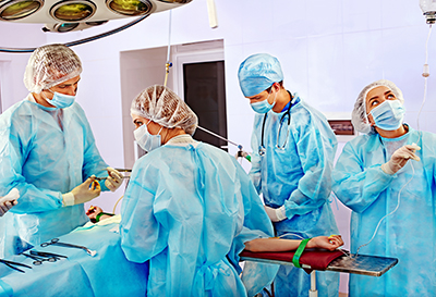 Medical Malpractice can happen. Surgeon at work in operating room.