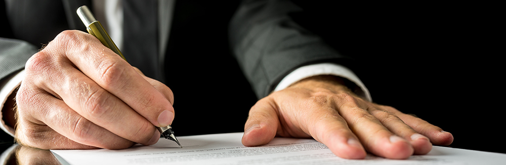 Business Startup: Businessman signing a paper document